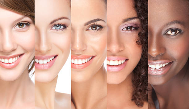 Close-up of 5 juxtaposed smiling young women stock photo