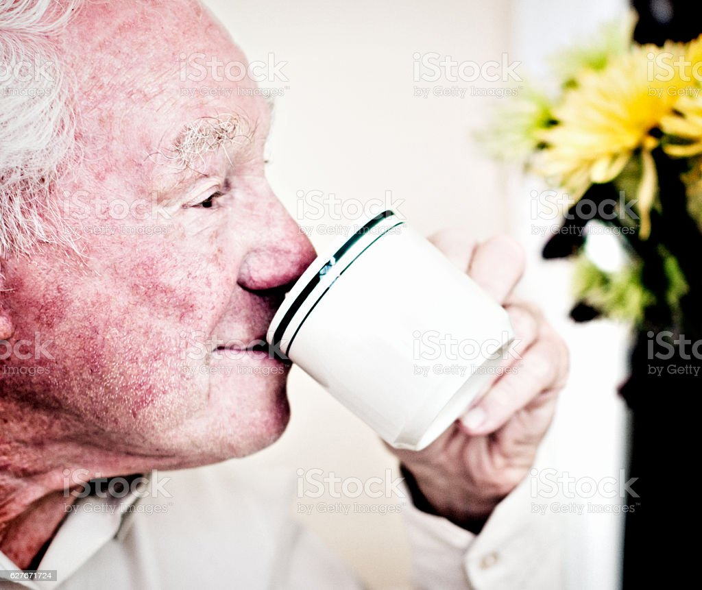Close-up of 80-plus man enjoying a cup of coffee stock photo