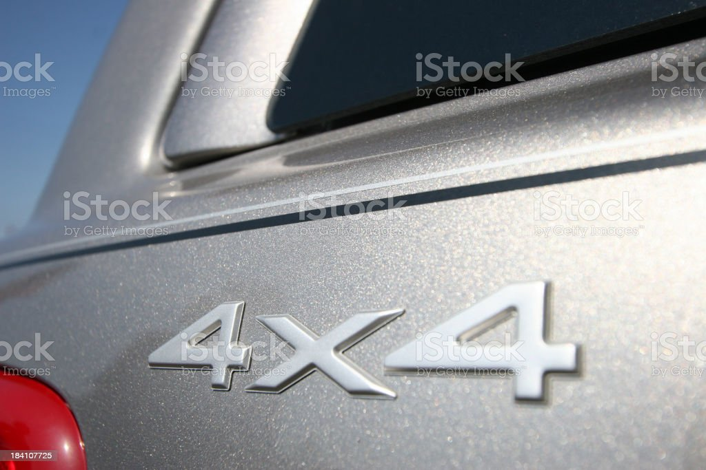 Close-up of a 4x4 logo on a silver suv stock photo