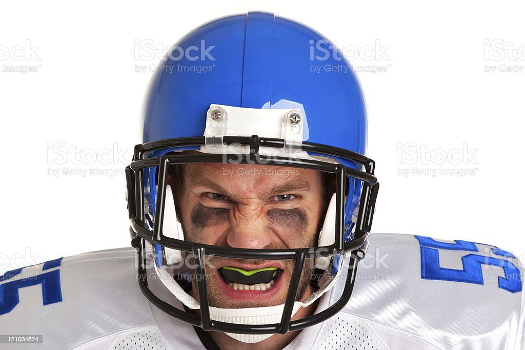 A closeup of a American football player in a blue helmet royalty-free stock photo