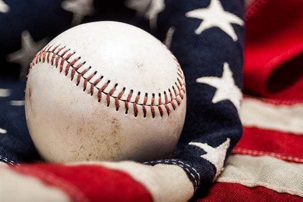 Close-up of a baseball on an American flag stock photo