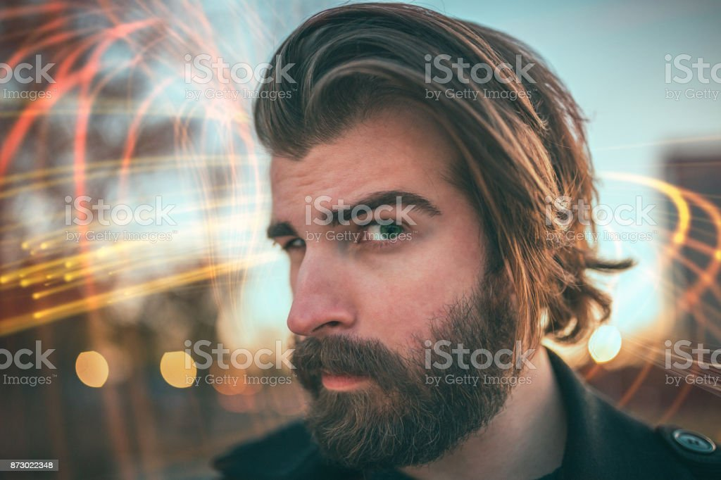 Close-up of a bearded man making funny face stock photo