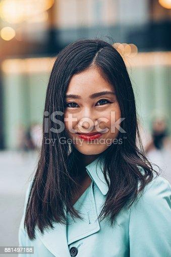 519052198 istock photo Close-up of a beautiful Asian ethnicity woman 881497188