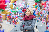 Closeup of a beautiful fashionable young woman. A walk in the autumn city.