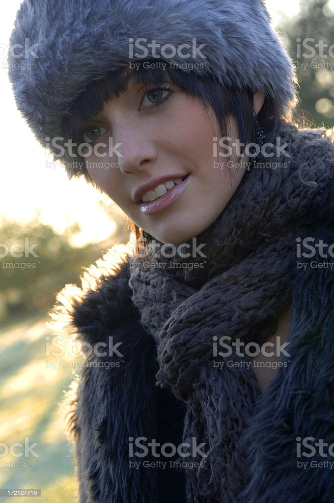 Closeup Of A Beautiful Girl Wearing A Fur Hat In Winter
