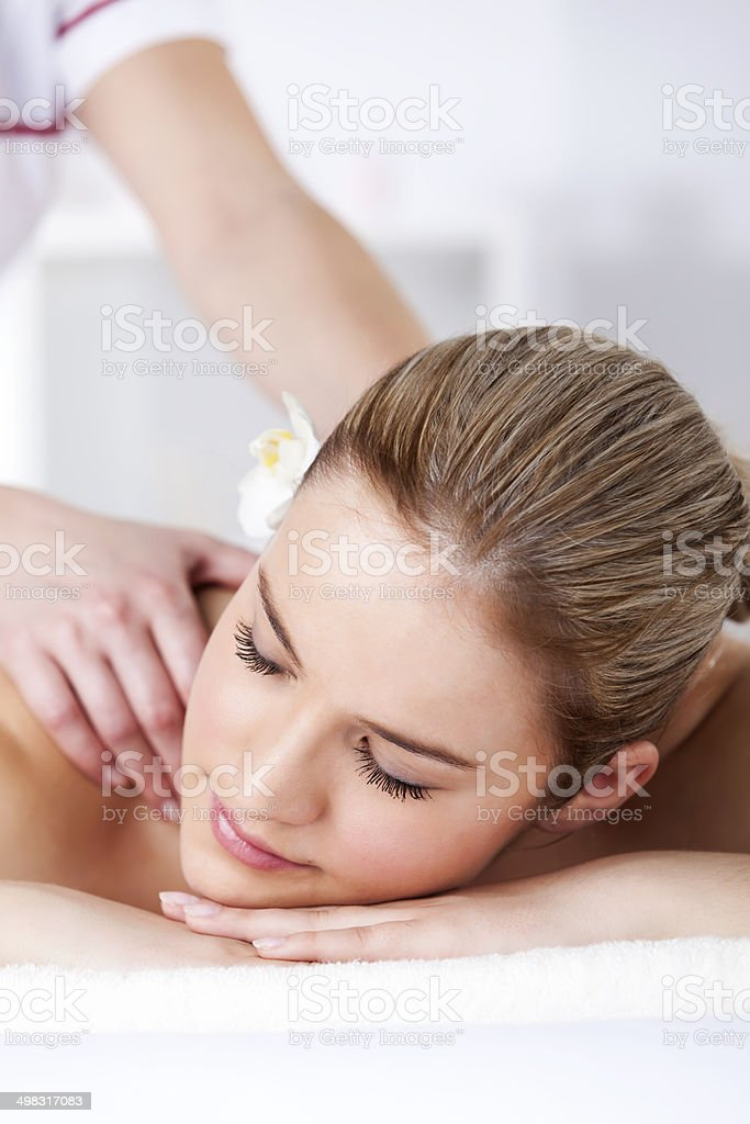 Close-up of a beautiful woman receiving back massage at spa royalty-free stock photo