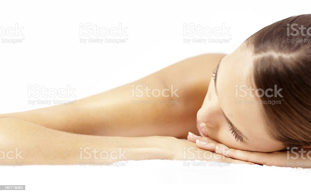 Close-up of a beautiful woman relaxing at spa royalty-free stock photo