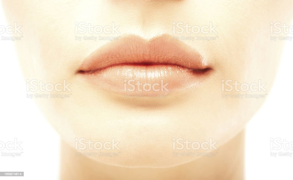 Closeup of a beautiful woman's full lips stock photo