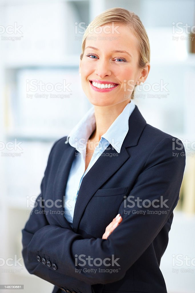 Close-up of a beautiful young businesswoman smiling royalty-free stock photo