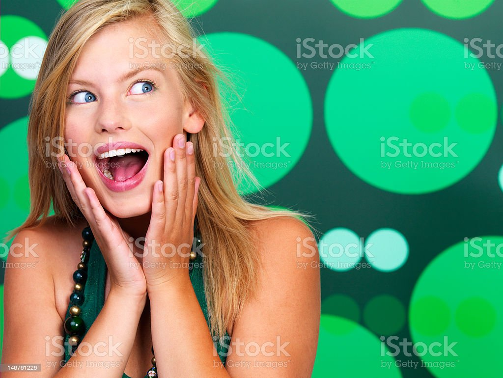 Close-up of a beautiful young woman looking surprised royalty-free stock photo