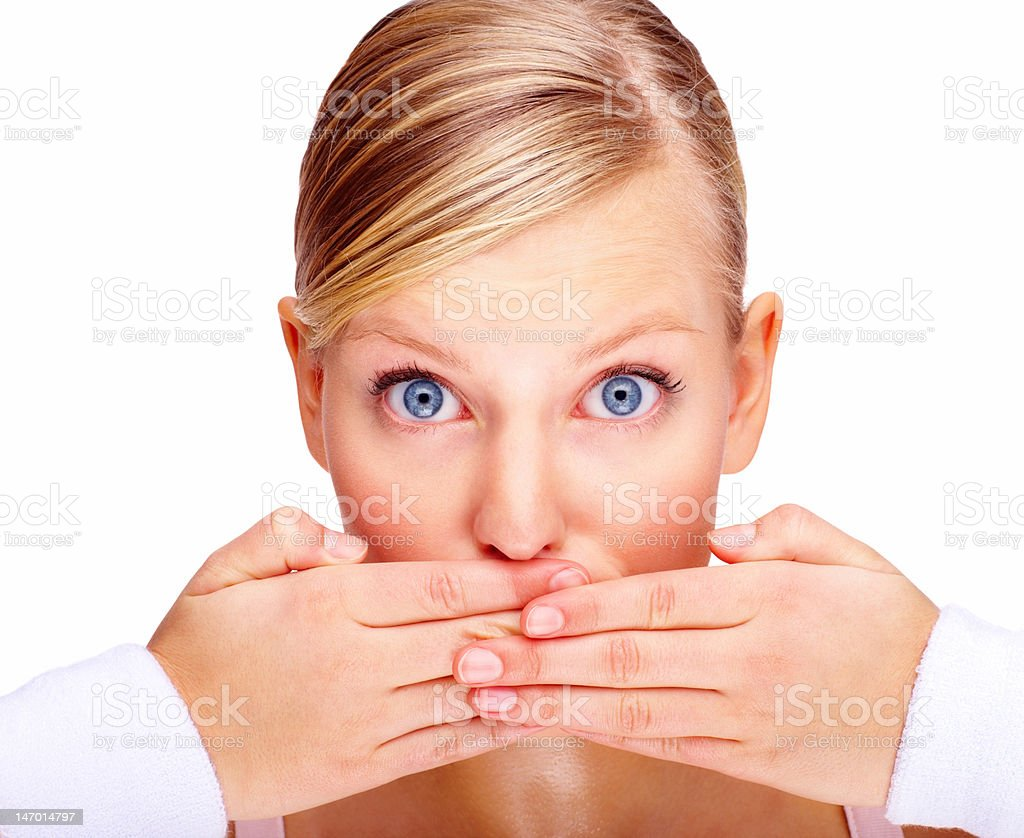 Close-up of a beautiful young woman with hands covering mouth royalty-free stock photo