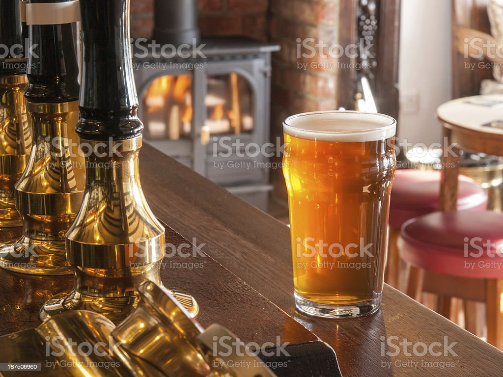 A close-up of a beer on a bar at an English pub stock photo