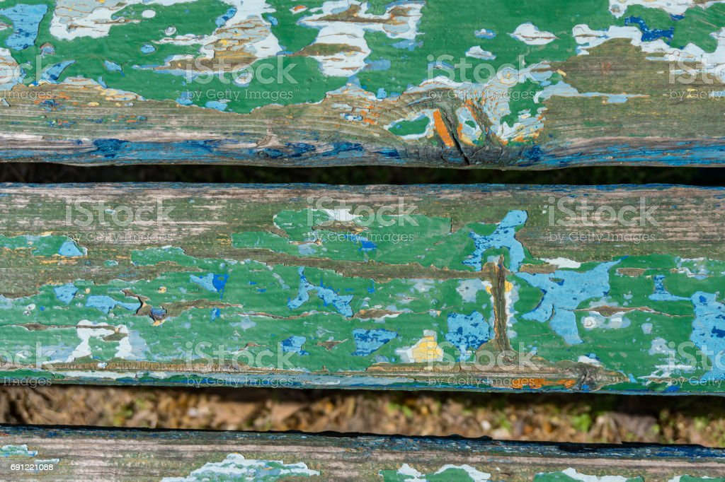 Close-up of a bench, look from above. Suitable for texture, background. Vintage green and turquoise with dull paint, nostalgia. stock photo