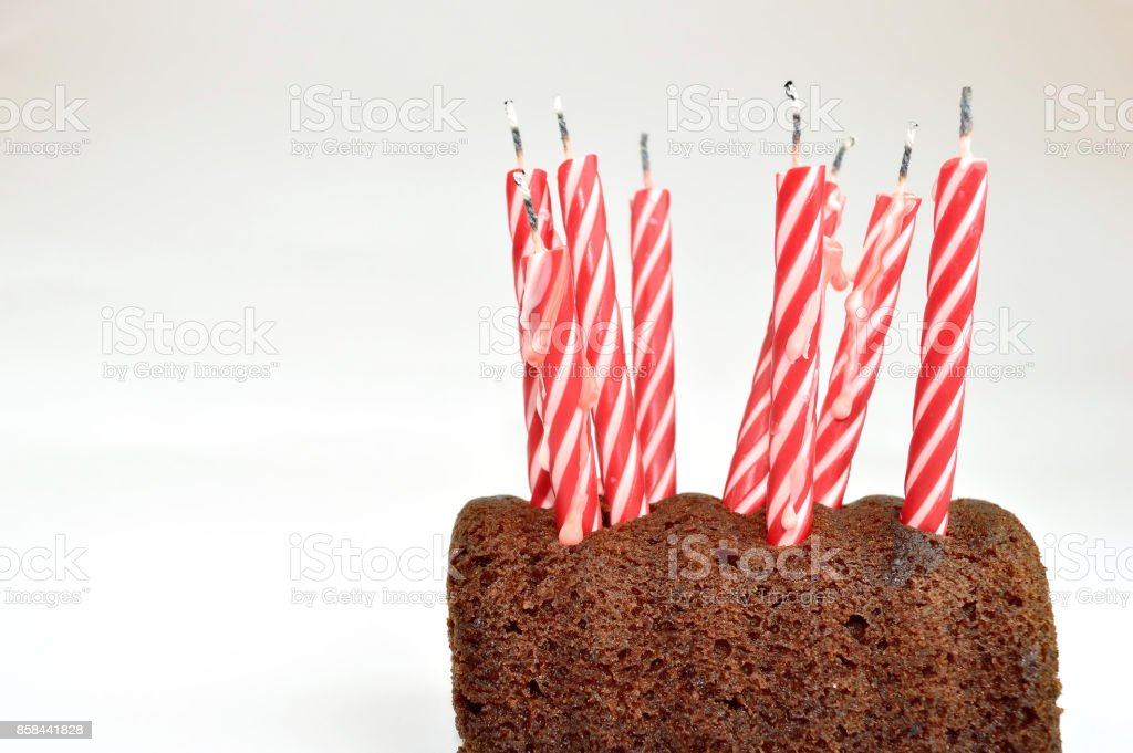 Closeup Of A Birthday Cake With A Bunch Of Candles On It Stock Photo