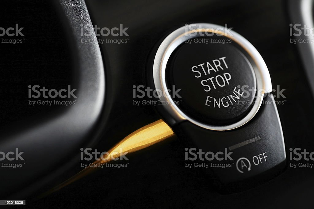 Close-up of a black automatic engine start and stop button stock photo