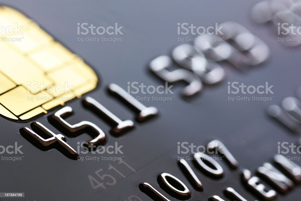 A close-up of a black credit card with the numbers 4511 stock photo