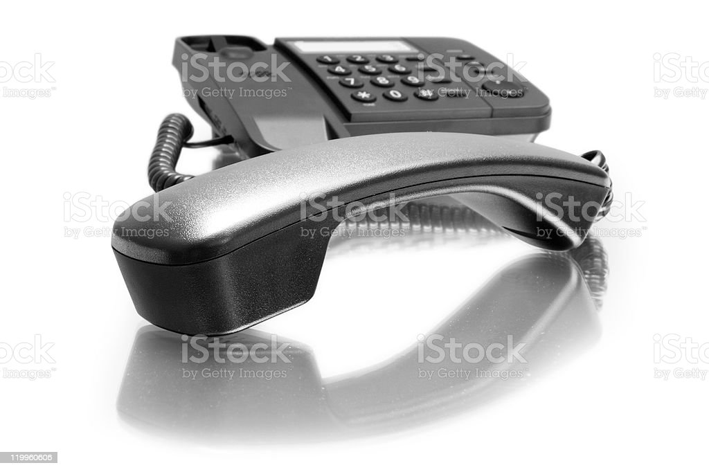 Close-up of a black telephone on white background stock photo