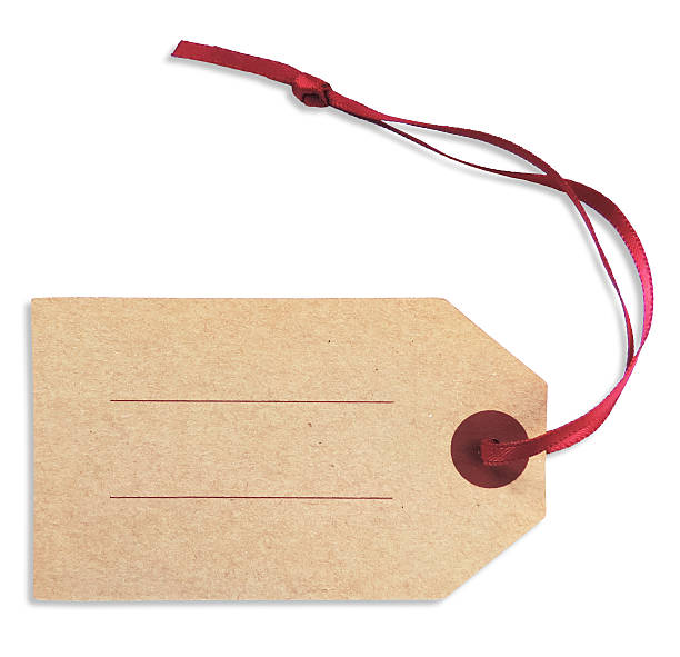 close-up of a blank gift tag with red ribbon over white - gift tag note stock photos and pictures