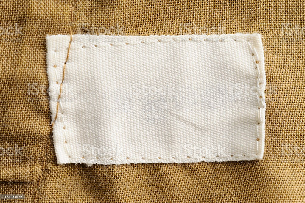 Close-up of a blank white clothing label stock photo