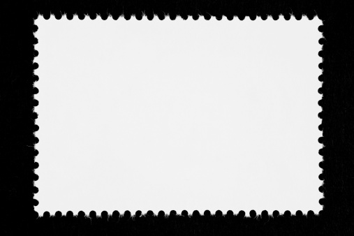 Close-up of a blank stamp isolated on black (black & white image)