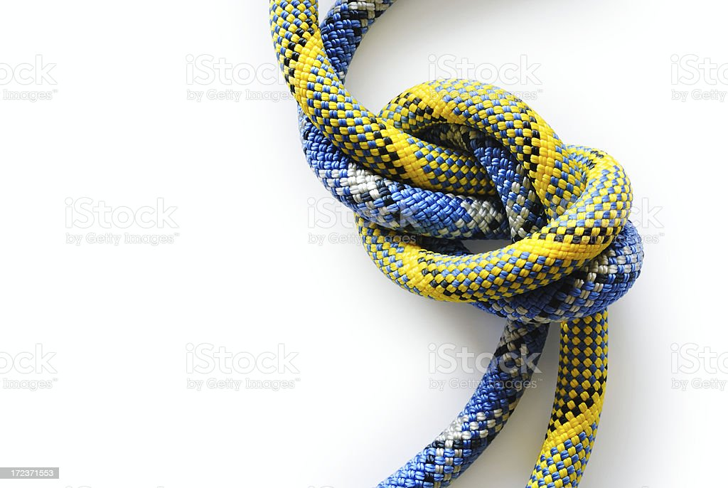 Close-up of a blue and yellow knot on white background royalty-free stock photo