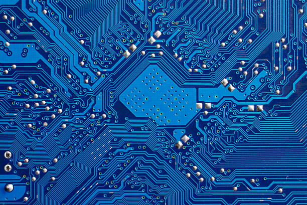 closeup of a blue computer circuit board - mother board stock photos and pictures