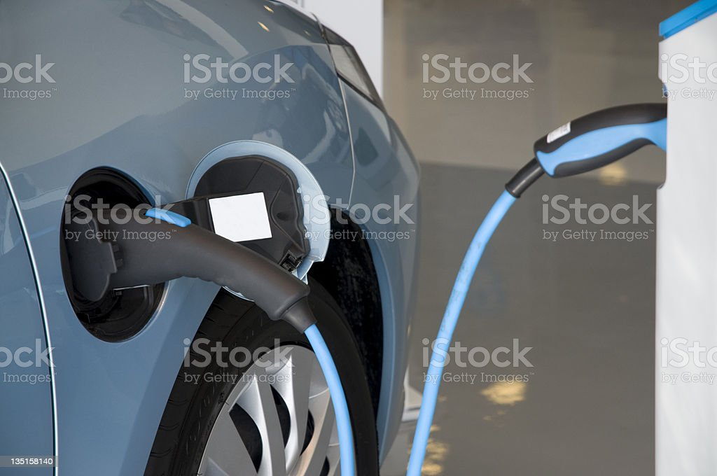 Close-up of a blue electric car charging royalty-free stock photo