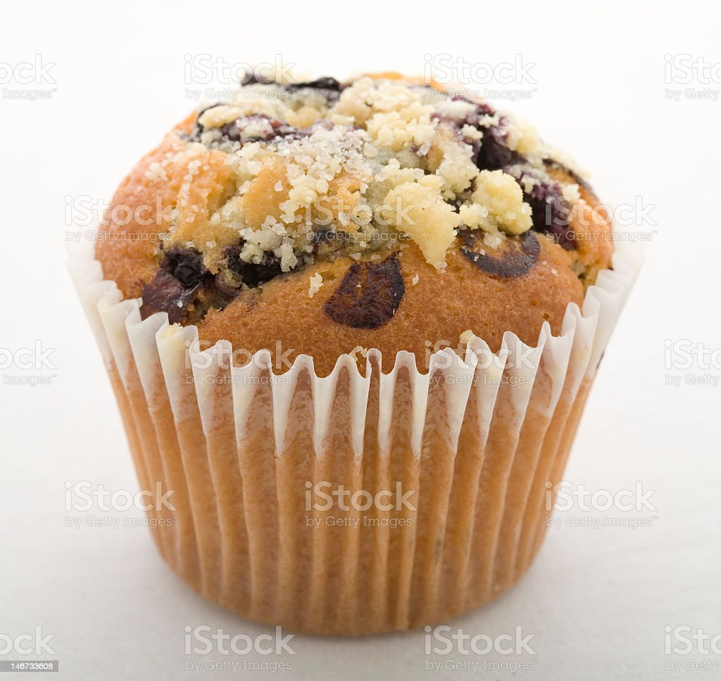 A close-up of a blueberry muffin on a white background royalty-free stock photo
