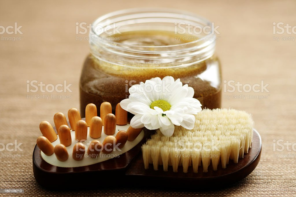Closeup of a body scrub brush and cream royalty-free stock photo