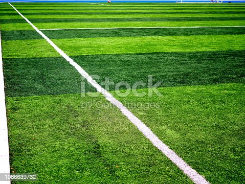 istock Close-up of a boundary line on a soccer field 1086639732