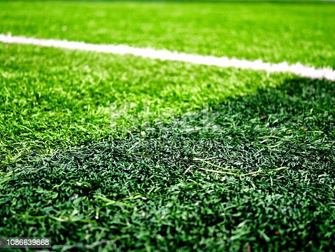 istock Close-up of a boundary line on a soccer field 1086639868
