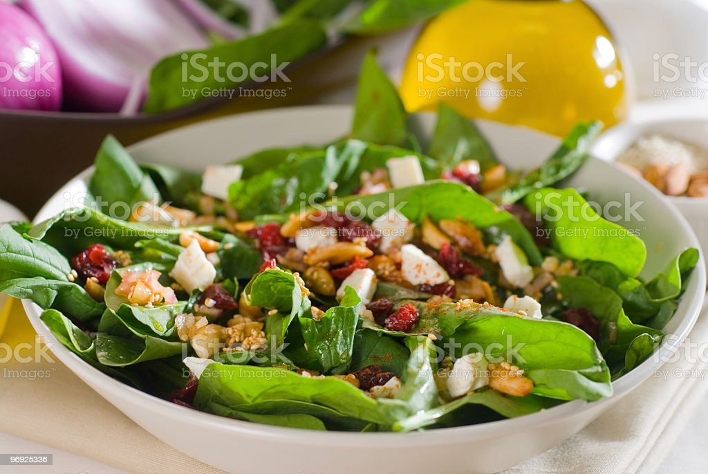 Close-up of a bowl filled with spinach salad royalty-free stock photo