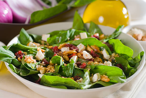 Close-up of a bowl filled with spinach salad stock photo