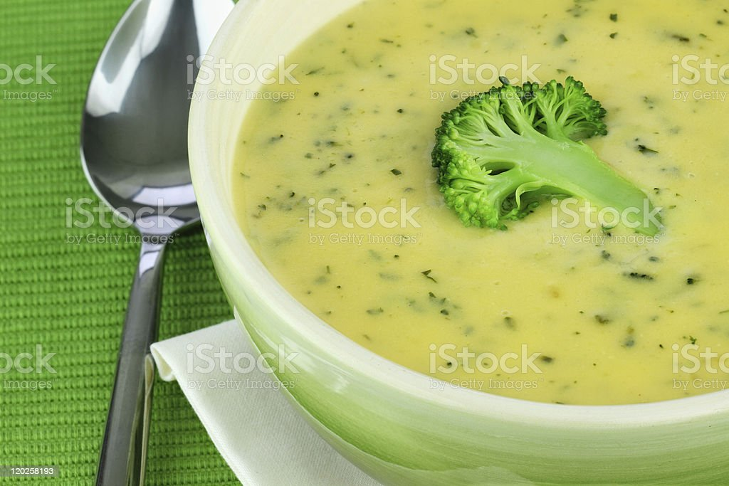 Close-up of a bowl of cream of broccoli soup stock photo