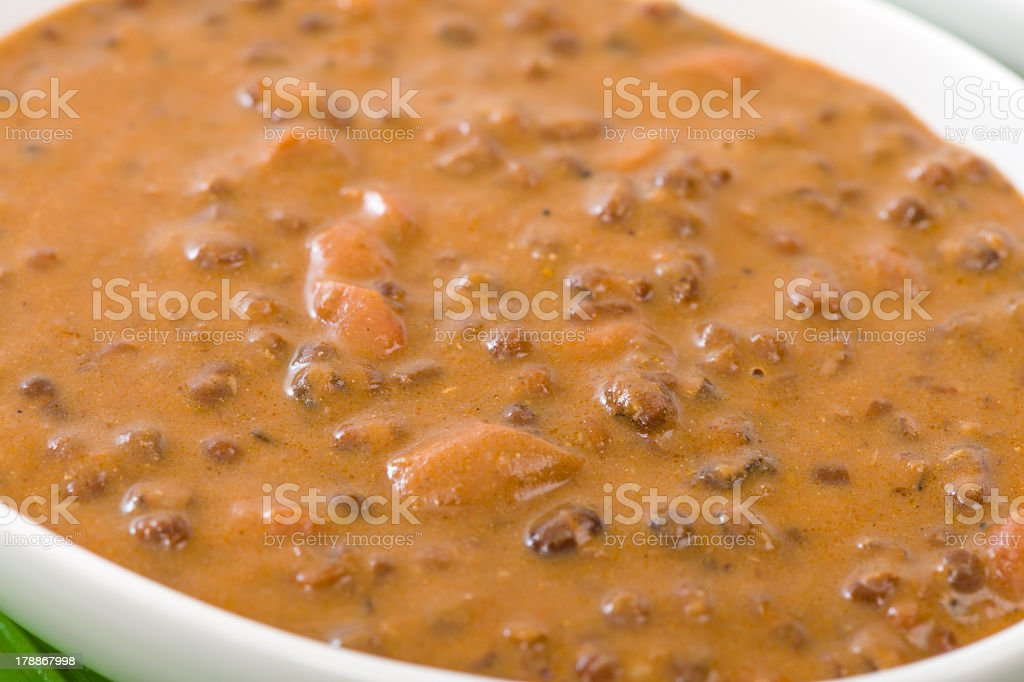 Close-up of a bowl of Dal Makhani in a white serving bowl stock photo