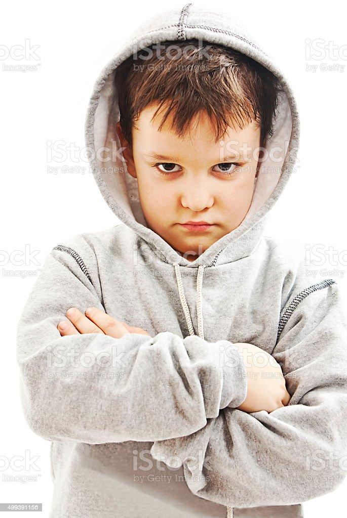 Closeup of a boy wearing a hoodie, underlit stock photo