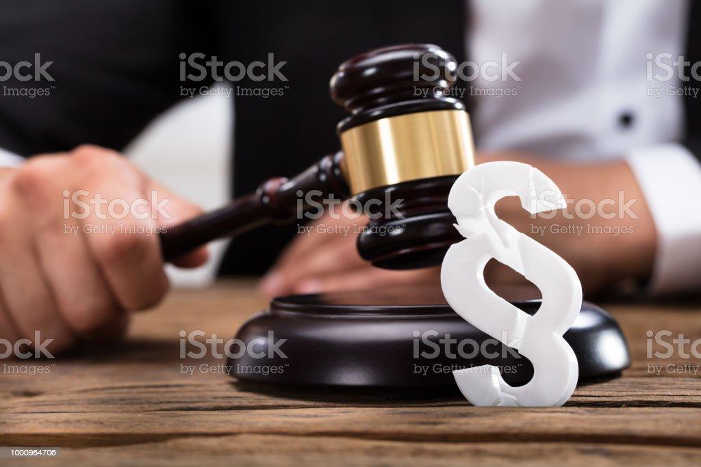 Closeup Of A Broken White Paragraph Symbol Stock Photo More