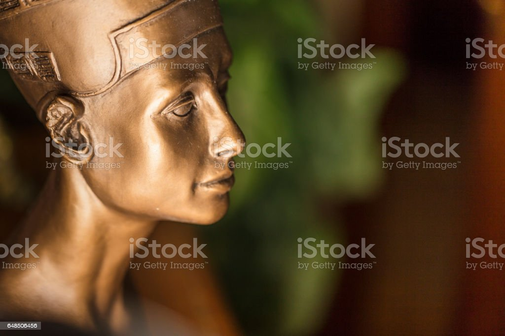 Close-up of a bronze colored Nefertiti bust, made with plaster. stock photo