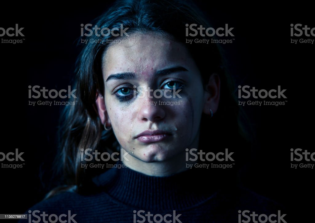 Closeup Of A Bullied Depressed Alone Tired Stressed Young Child Girl Crying Isolated On Black Background Human Emotions Childhood Depression Emotional Pain Bullying And Child Abuse Concept Stock Photo Download Image