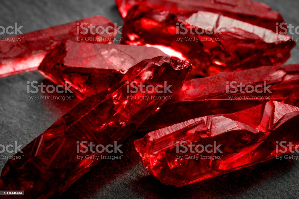 Closeup of a bunch of red rough uncut ruby crystals stock photo