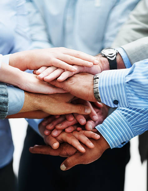 Closeup of a business people with hands together Agreement - Closeup of a business colleagues with their hands together passion stock pictures, royalty-free photos & images