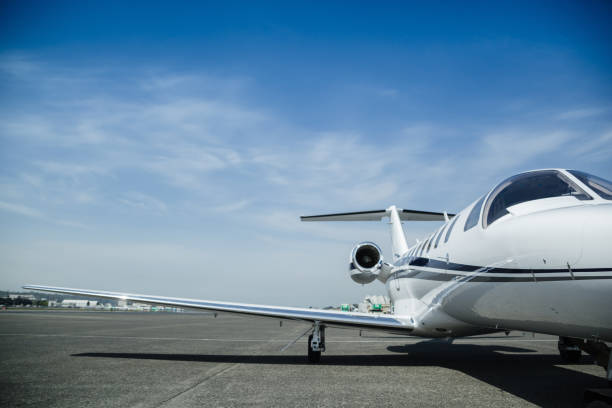 Close-up of a business private jet at an airport stock photo