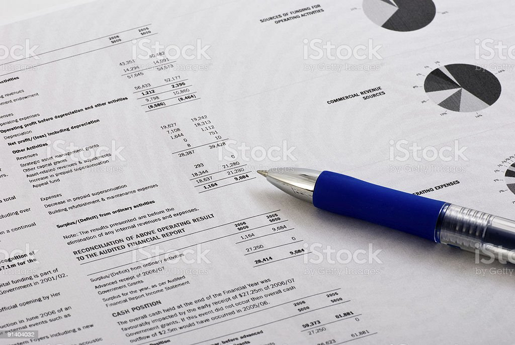 Closeup of a business report and a pen stock photo