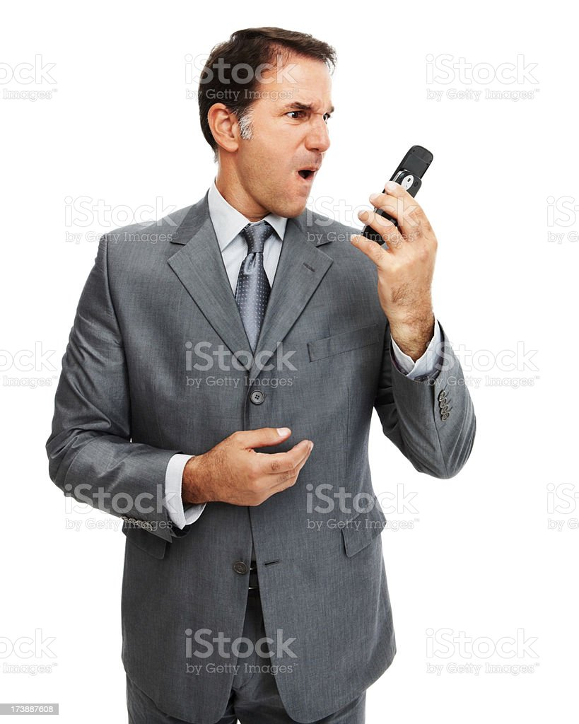 Close-up of a businessman looking irritated with cellphone royalty-free stock photo