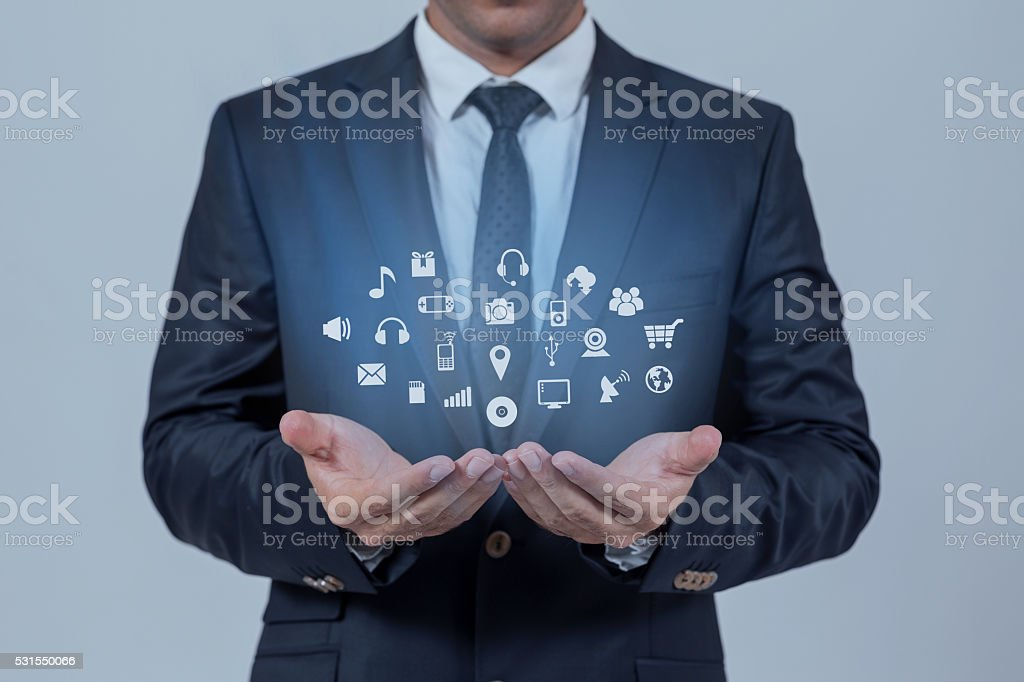 Close-up of a businessman securing apps stock photo