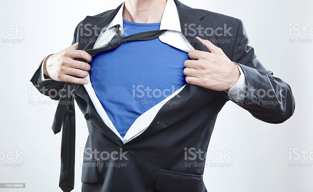 Closeup of a businessman showing the superhero suit stock photo