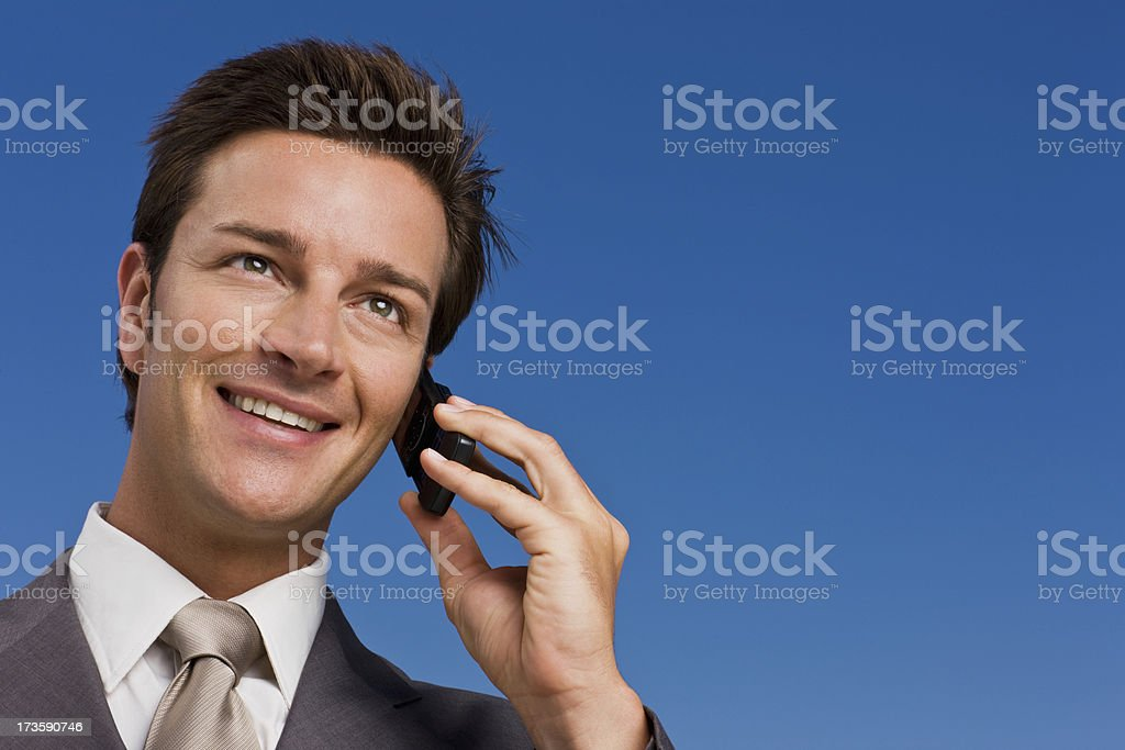 Closeup of a businessman using cell phone royalty-free stock photo