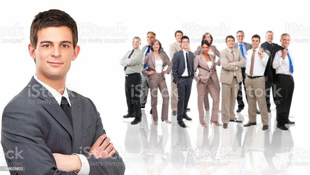 Close-up of a businessman with colleagues standing behind him royalty-free stock photo