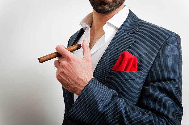 Close-up of a businessman with handkerchief and a cigar stock photo