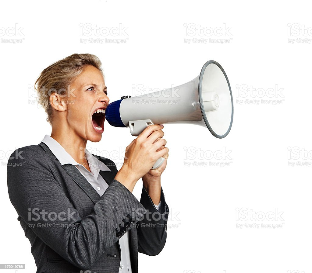 Close-up of a businesswoman shouting in megaphone royalty-free stock photo
